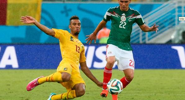 Numa estreia com mais de 13 mil mexicanos na Arena das Dunas, debaixo de um temporal  México leva a vitória sobre Camarões. Foto: FIFA via Getty Images -