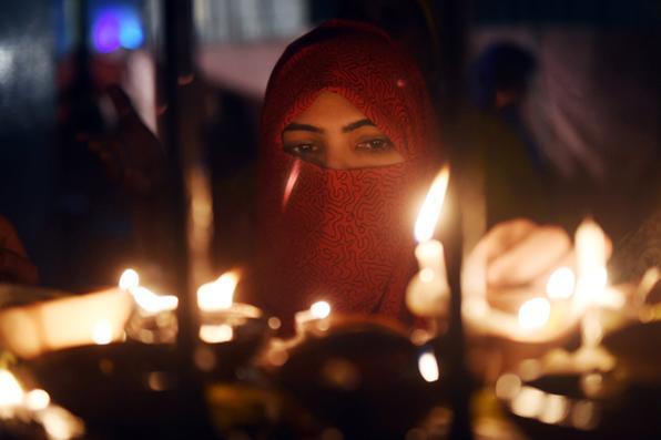 Festival religioso  'Urs' em Lahore. Foto: AFP PHOTO / ARIF ALI  -