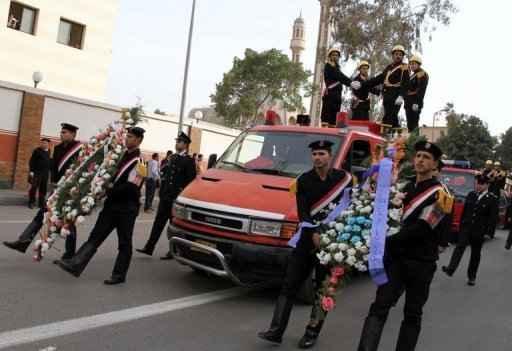 Milhares de pessoas participaram, neste domingo, dos funerais dos 31 mortos. Foto: AFP Ahmed Mahmoud.