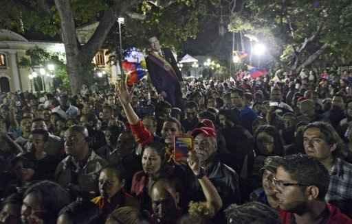 Seguidores do presidente falecido da Venezuela, Hugo Chávez, nas ruas de Caracas. Foto: AFP/ Leo Ramírez