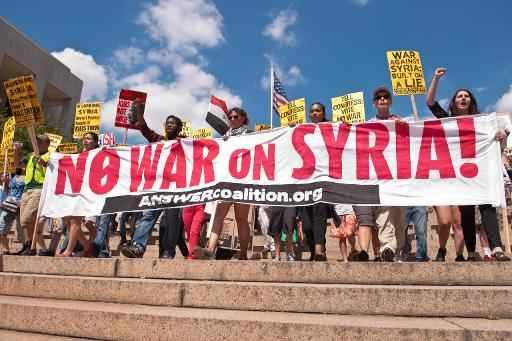 Manifestantes protestaram no s�bado da Casa Branca at� o Capit�lio em Washington contra a guerra na S�ria. Foto: Nicholas Kamm/AFP