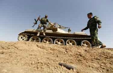 Membros das for�as curdas se posicionam em 21 de junho de 2014, na cidade iraquiana de Basheer � AFP KARIM SAHIB