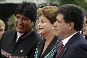 Evo Morales, Dilma Rousseff e Horacio Cartes durante a c�pula do Mercosul em Caracas, em 29 de julho de 2014. Foto: � AFP/LEO RAMIREZ (Evo Morales, Dilma Rousseff e Horacio Cartes durante a c�pula do Mercosul em Caracas, em 29 de julho de 2014. Foto: � AFP/LEO RAMIREZ)