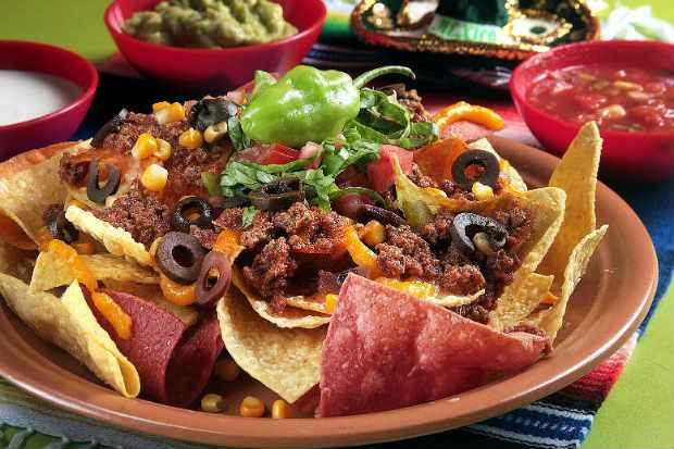 Prato Carlos Santana, feito de nachos com Picadillo, é um dos sucessos entre os pratos salgados. Foto: Escalantes/Divulgação