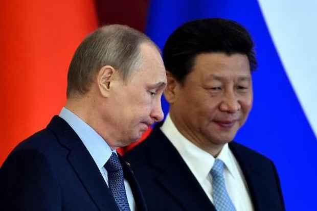 Os presidentes da Rússia, Vladimir Putin, e China, Xi Jinping, durante reunião em 8 de maio em Moscou. Foto: Kirill Kudryavtsev/AFP
