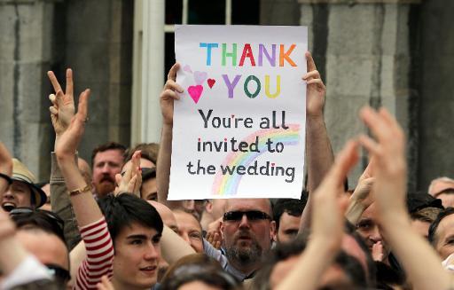 Apoiadores do casamento entre pessoas do mesmo sexo comemoram vitória. Foto: Paul Faith/AFP