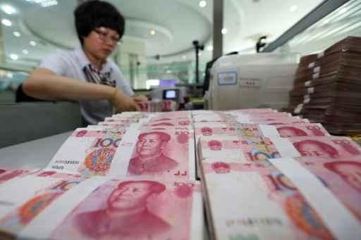 A desvalorização da moeda chinesa é um passo no longo caminho a ser percorrido pelo país para liberalizar a cotação da divisa, apontam analistas. Foto: AFP