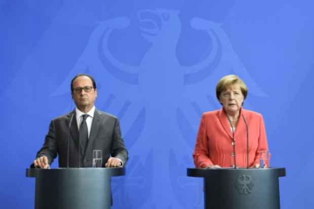 O presidente francês, François Hollande, e a chanceler alemã, Angela Merkel. (Tobias Schwarz/AFP )
