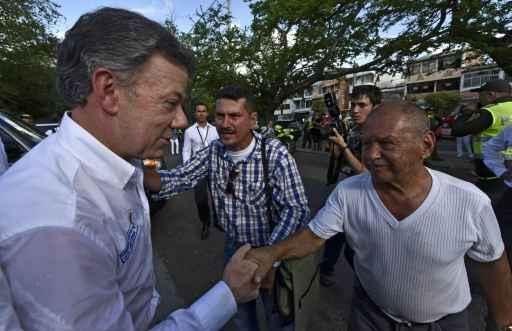 Juan Manuel Santos prometeu facilitar a vida das pessoas. Foto: Luis Acosta/AFP
