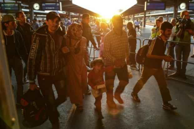 Imigrantes chegam à estação de trens de Munique em 12 de setembro de 2015. (Foto: AFP Philippe Guelland)