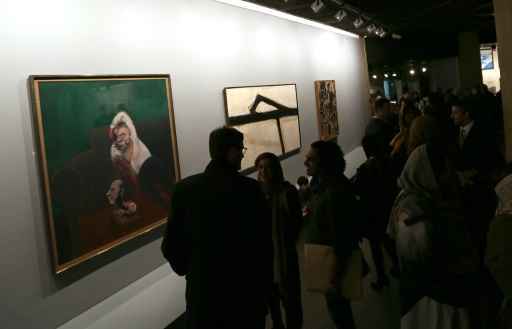 Cerimônia de abertura da exposição, que acontece no Museu de Arte Contemporânea de Teerã. © AFP ATTA KENARE