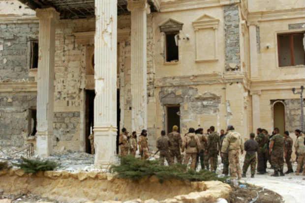ropas sírias são vistas em Palmira, em 24 de março de 2016. Foto: STR/AFP
