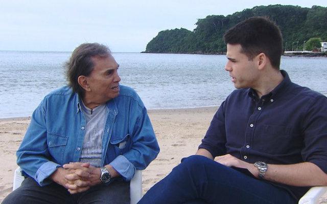 Dedé dá entrevista a Luiz Bacci no Domingo Show. Foto: Divulgação/Record