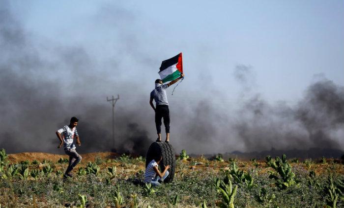 O objetivo é impedir a passagem de mergulhadores do Hamas. Foto:  Mohammed Abed/AFP