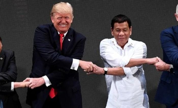 Os presidentes Donald Trump (EUA)e Rodrigo Duterte (filipinas) Foto:NOEL CELIS/AFP