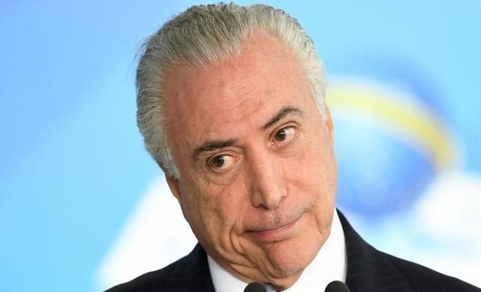 O presidente afirma que o PMDB vai tentar fechar questão para obrigar deputados a votarem a favor da reforma. Foto: Evaristo Sá/AFP (Foto: Evaristo Sá/AFP)