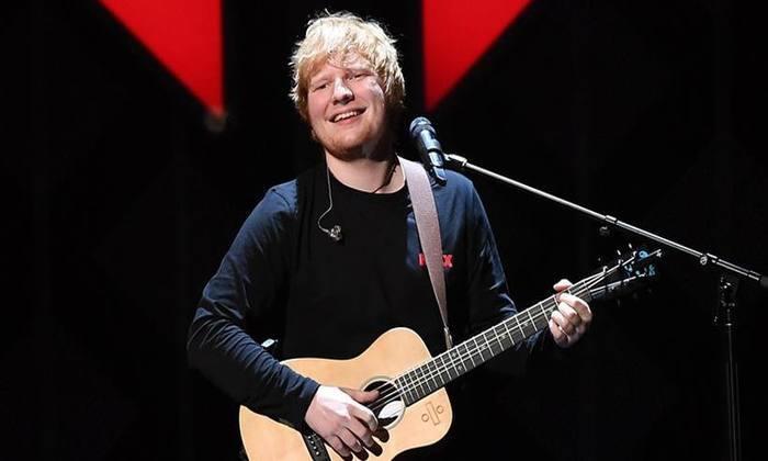 Ed Sheeran não seria o primeiro famoso a se apresentar num casamento real. Ellie Goulding cantou para os familiares no casamento de Kate e William. Foto: Angela Weiss/ Agência France-Presse.