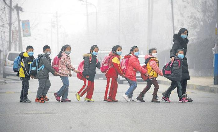 O impacto seria sentido principalmente em países muito populosos. China economizaria 55% em saúde pública. Foto: AFP Photo (Foto: AFP Photo)
