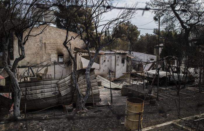 Mais de 30 corpos ainda não foram identificados, segundo a rede pública ERT. Foto: ANGELOS TZORTZINIS / AFP