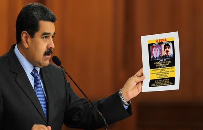 O presidente Nicolás Maduro acusou os parlamentares Julio Borges e Juan Requesens de terem tentado assassiná-lo com drones carregados com explosivos. Foto: AFP