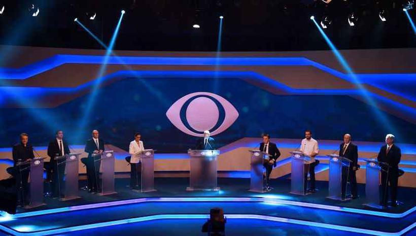 Presidenciáveis na TV Band: orientação é que nome de Lula seja evitado também em debates televisivos. Foto: Nelson Almeida/AFP