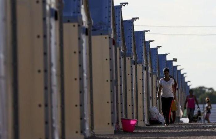 A direção de um dos abrigos informou que os imigrantes chegaram em estado de choque, com medo e cansados. Foto:  Marcelo Camargo/Agência Brasil