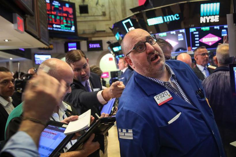 Mau humor afetou também as bolsas de valores no exterior, como a de Nova York, que recuou 0,30%. Foto: Drew Angerer/Getty Images/AFP