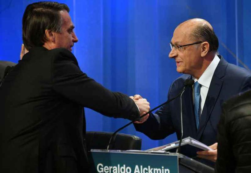 A coligação de Bolsonaro alega que a campanha de Alckmin 'maculou a honra'. Foto: Nelson Almeida/AFP