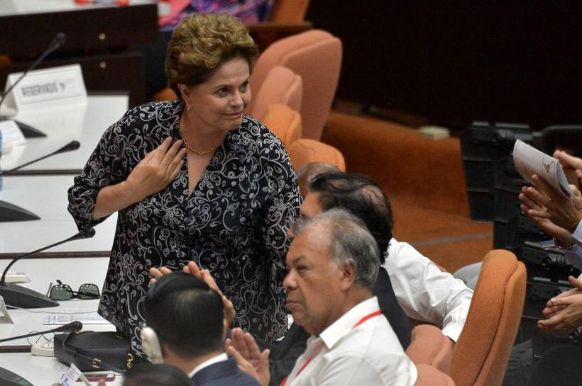 """Dilma: """"Não foram reduzidos (os recursos) no meu governo. Você não vai comparar R$ 391 milhões com R$ 50 mil"""". Foto: Yamil Lage/AFP"""