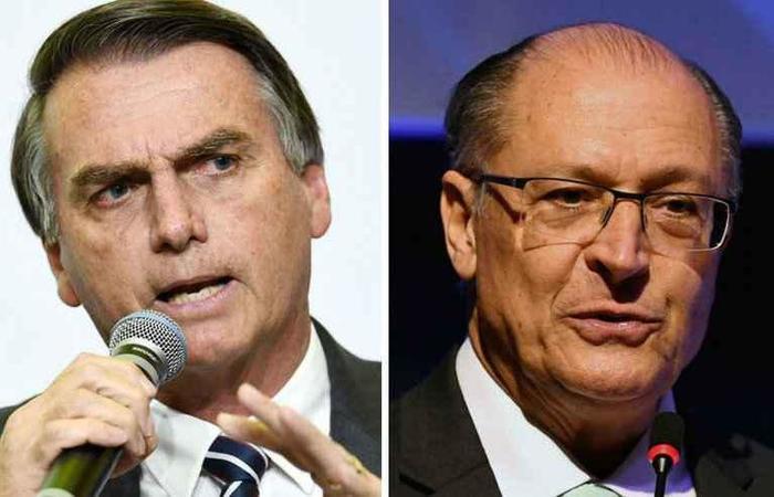 Segundo a última pesquisa Ibope/Estadão/TV Globo, Alckmin está em quarto lugar, com 9% das intenções de voto. Bolsonaro apresentou  22%. Fotos: Arquivo / AFP