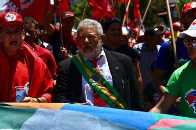 O autônomo José Bezerra (centro) partipa do evento fantasiado do ex-presidente petista. Foto: Paulo Paiva/Divulgação