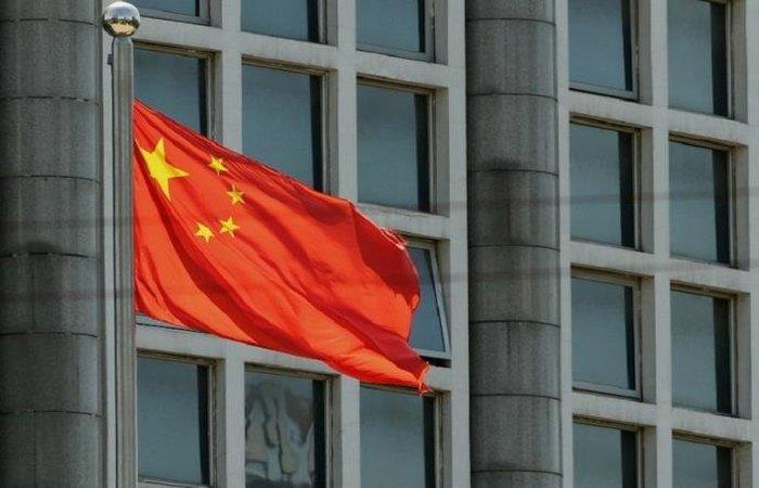 O Parlamento chinês aprovou no ano passado uma lei que pune com até três anos de prisão o insulto ao hino nacional. Foto: STR / AFP / CP