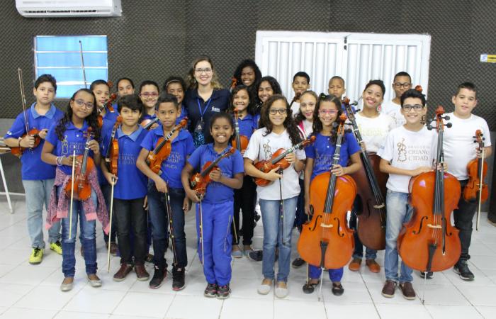A Orquestra Criança Cidadã dos Meninos do Coque é um projeto social incentivado pelo Ministério da Cultura. Foto: Orquestra Criança Cidadã/Divulgação.