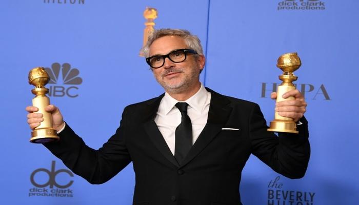 O mexicano Alfonso Cuarón conquistou dois Globos de Ouro com %u201CRoma%u201D. Foto: AFP Photo