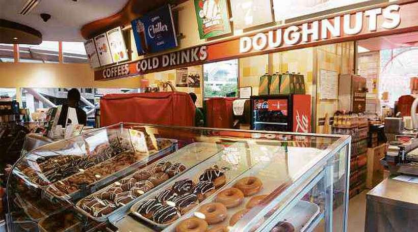 A Krispy Kreme Doughnuts, rede americana de rosquinhas, também integra o portfólio da Jab Holdings. Foto: Nicholas Kamm/AFP