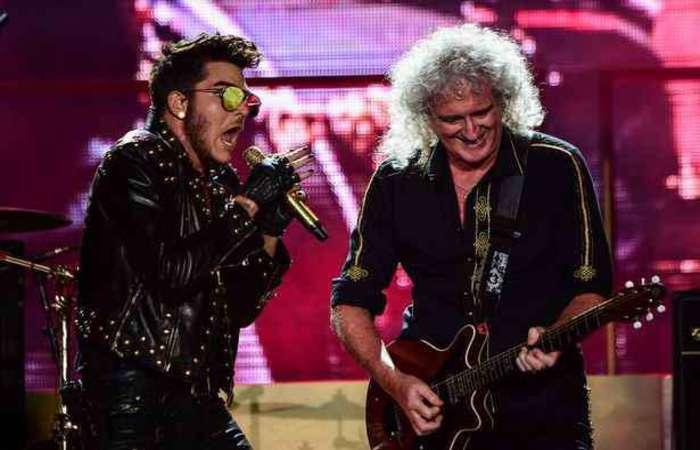 Adam Lambert e Queen tocando no Rock in Rio. Foto: AFP PHOTO/ CHRISTOPHE SIMON